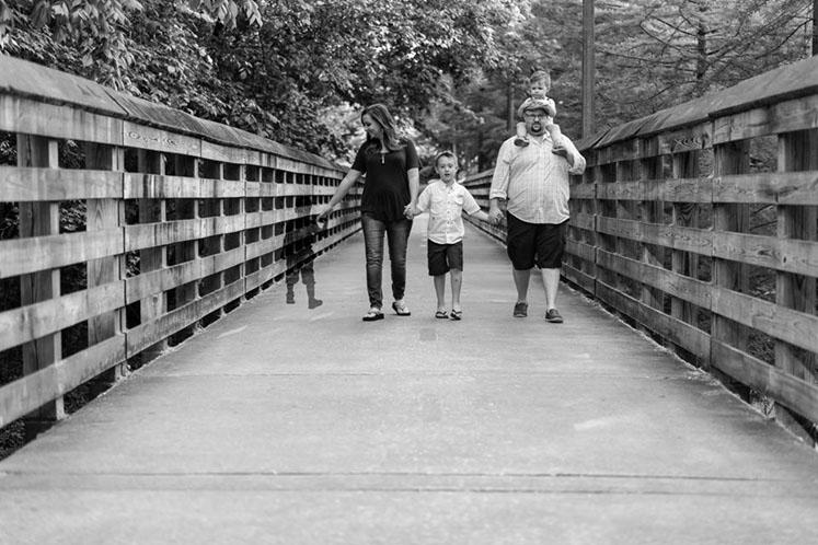 Family walking, black and white